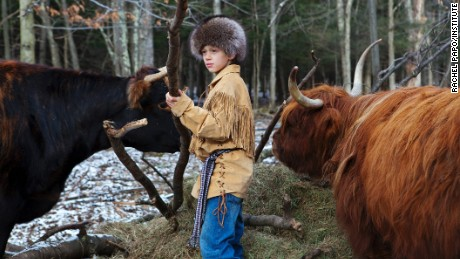 Roan with Kilda and April, 2011. Part of the series Homeschooled, about a small group of homeschooled children living in the Catskill mountains of New York. Roan and his sister Iris live on a family farm with their parents, who follow a nature based learning method and believe their children would benefit more from spending their time within nature and at home, rather than on a school bus and in a classroom. Apart from studying traditional subjects, their daily activities involve helping with every aspect of farm work and discovering their own topics of interest. Roan and Iris are fascinated by colonial history, are part of a little league soccer team and love to swim and ice-skate on their pond.