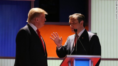 Donald Trump (left) and Sen. Ted Cruz speak during a commercial break in the Fox Business Network Republican presidential debate at the North Charleston Coliseum and Performing Arts Center on January 14, 2016, in North Charleston, South Carolina.