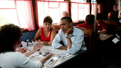 Then-Democratic presidential hopeful, U.S. Sen. Barack Obama, D-Ill., right, listens to Donna Richardson, left, of Concord during a quick stop at the Tumble Inn diner where he met with patrons and ordered a cheeseburger to go in Claremont, N.H., on Monday, Aug. 13, 2007.