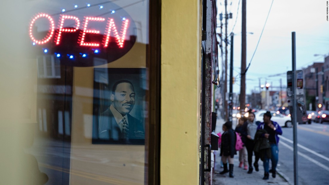 A portrait of the Rev. Martin Luther King Jr. looks out from a restaurant window on Edgewood Avenue one block south of historic Auburn Avenue. Revitalization has taken hold quicker on Edgewood than on Auburn, though some call the development gentrification.