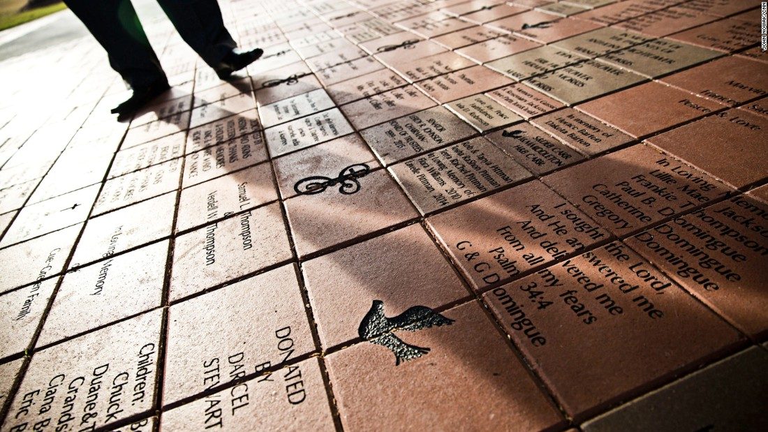 Custom bricks line the walkway of Ebenezer Baptist Church, which stands across from the King Center in Atlanta. As generations leave the inner city and the church loses membership, members are trying to bring in donations through the bricks.
