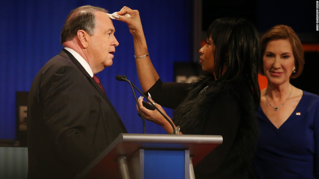 Republican presidential candidate Mike Huckabee, participating in a debate in North Charleston, South Carolina, has his makeup touched up during a commercial break on Thursday, January 14.