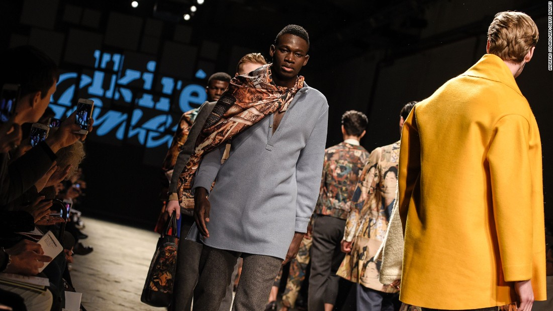 Due to Italian governmental policy most of the personal details of the men cannot be released but we know they are from Gambia and Mali. The men were cast in an effort to raise awareness of the on-going migrant crisis.<em><br />An asylum seeker (C) presents a creation for fashion house Ikire Jones.</em>
