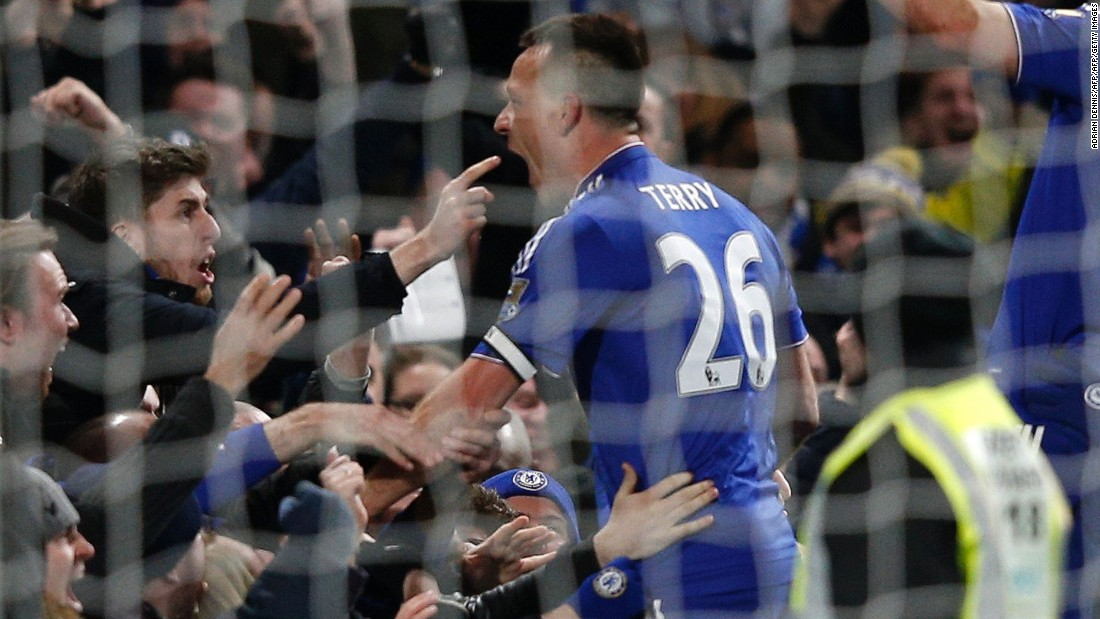 John Terry celebrates with Chelsea fans after scoring a 98th-minute goal to deny Everton on Saturday.
