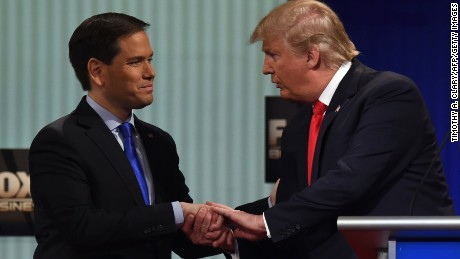 Republican Presidential candidates, businessman Donald Trump (R) and Florida Senator Marco Rubio shake hands after the Republican Presidential debate sponsored by Fox Business and the Republican National Committee at the North Charleston Coliseum and Performing Arts Center in Charleston, South Carolina on January 14, 2016.