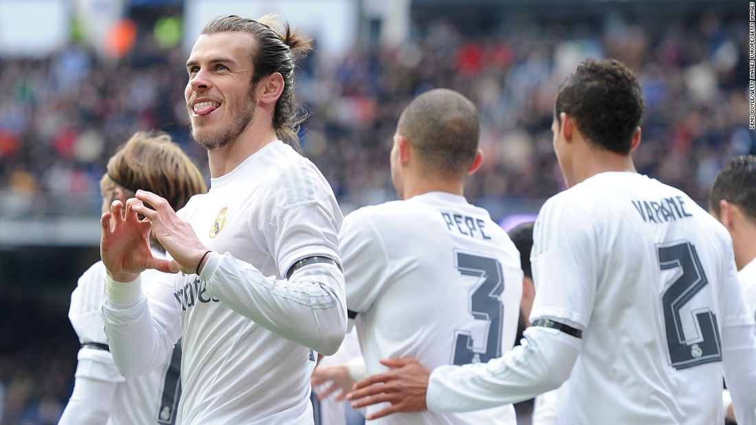 Gareth Bale with his trademark celebration after putting Real Madrid ahead against Sporting Gijon in the seventh minute in the Santiago Bernabeu.