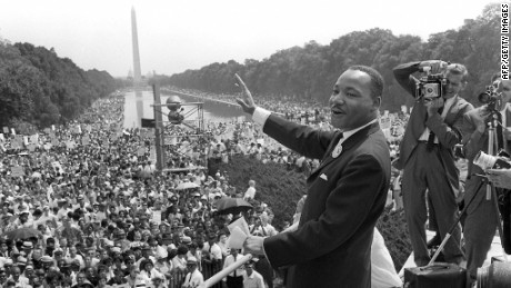 "Martin Luther King Jr. waves to supporters from the steps of the Lincoln Memorial on August 28, 1963, during the march on Washington, when King delivered his famous ""I Have a Dream"" speech."
