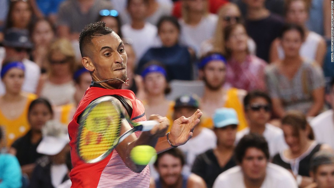 Australian Nick Kyrgios blitzed Spain's Pablo Carreno Busta 6-2 7-5 6-2 to cruise into the second round.