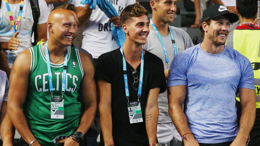 Friend and fellow Australian tennis star Thanasi Kokkinakis, center, looks on as Kyrgios won his first-round match. The 19-year-old Kokkinakis, one of the youngest players in the world top 100, suffered a shoulder injury in December that ruled him out of the tournament.