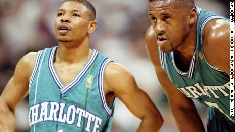 6 foot-7-inch forward Rafael Addison stoops to Muggsy's level during a game against the Dallas Mavericks in Texas. The Hornets went down 86-84 on this occasion.