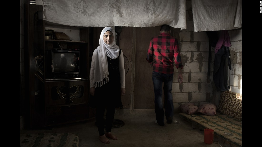 Amal, 14, left Syria with her family three years ago. Her future husband is 28-year-old Ahmad, right. The family wants to marry her off, and she agrees with this decision, said photographer Laura Aggio Caldon. Many Syrian refugees are marrying off their children to protect them from war and poverty.