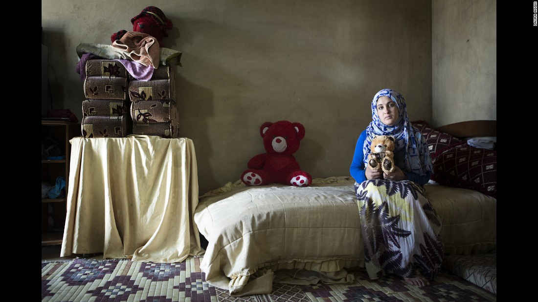 Rukayya, 14, holds a plush bear that was given to her as an engagement gift. Her mother said she would never have wanted one of her daughters to get married so young, but the crisis in Syria has changed everything.