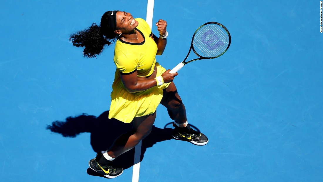 Serena Williams celebrates a point during her first-round win at the Australian Open on Monday, January 18. Williams won the tournament last year.