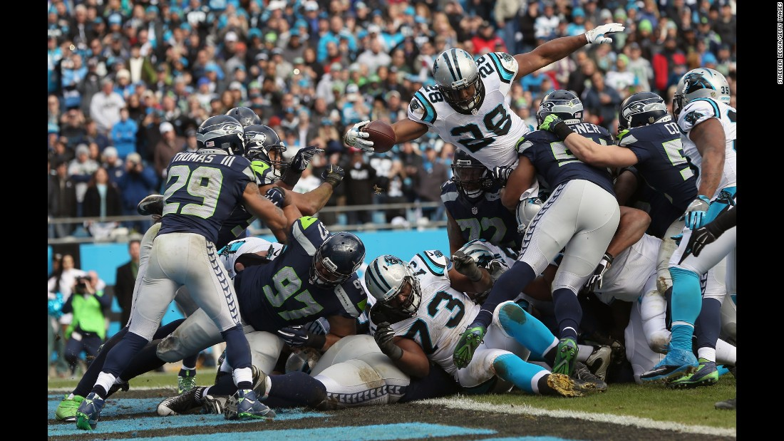 Carolina running back Jonathan Stewart leaps over the goal line during the Panthers' 31-24 victory over Seattle on Sunday, January 17. Carolina, which has lost only one game this season, will host Arizona in the NFC Championship game.