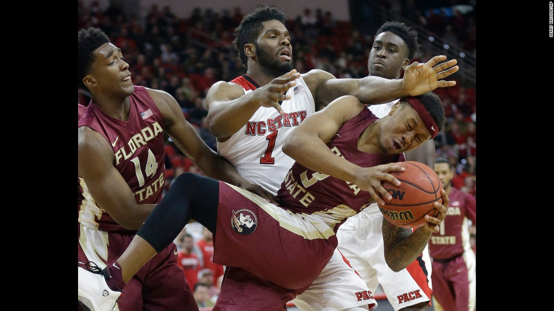 Florida State's Benji Bell, foreground, collides with North Carolina State's Lennard Freeman during a game in Raleigh, North Carolina, on Wednesday, January 13.