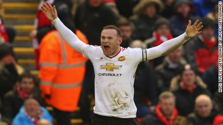 Rooney celebrates after scoring the winning goal for Manchester United during Sunday's English Premier League stand off against Liverpool, reaching a record-breaking 176 goals for the club.