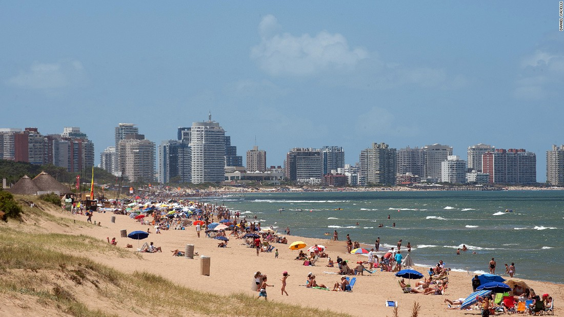 Tourists enjoy the sun on Punta del Este's La Mansa beach. Temperatures can climb as high as 40 C in December to February, while July to September are the coldest months.