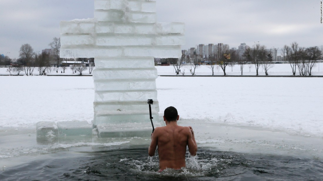A man uses a selfie stick in front of an ice cross during Epiphany celebrations in Kiev, Ukraine, on Tuesday, January 19. Many believers jump into rivers and ponds to cleanse themselves with water deemed holy for the day.