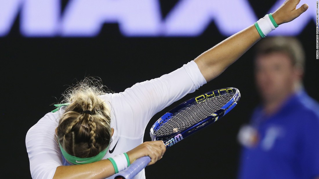 Belarus' 14th seed Victoria Azarenka salutes the Melbourne crowd after beating Alison Van Uytvanck of Belgium 6-0 6-0.