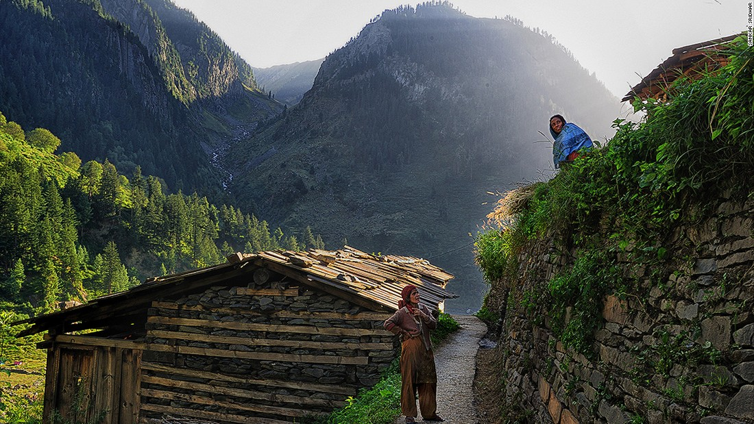 Bara Bangal's age shows everywhere, from the huts, to the trails through the village, and the walls that keep the mountainside from caving in. Here, two women chat while keeping a lookout for movement on the mountains that could be their husbands leading their flock back to the village.