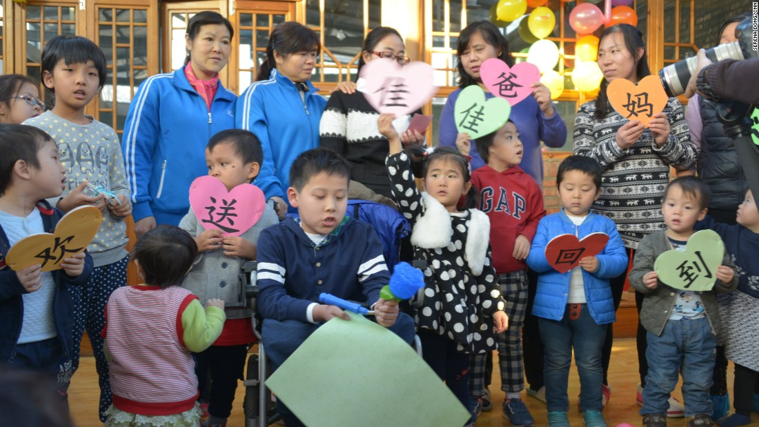 "Jason's friends and nannies from Alenah's Home orphanage in Beijing throw a farewell party for him on January 9, 2016. In China, he was known as JiaJia. The signs read: ""Farewell to JiaJia, going to his parents."" This is the moment they've anticipated and dreaded; saying goodbye to a boy many at the home consider their older brother."
