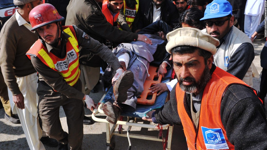 Rescue workers transport a wounded man to a hospital following an attack by gunmen on Bacha Khan University in Charsadda, Pakistan, on Wednesday, January 20.
