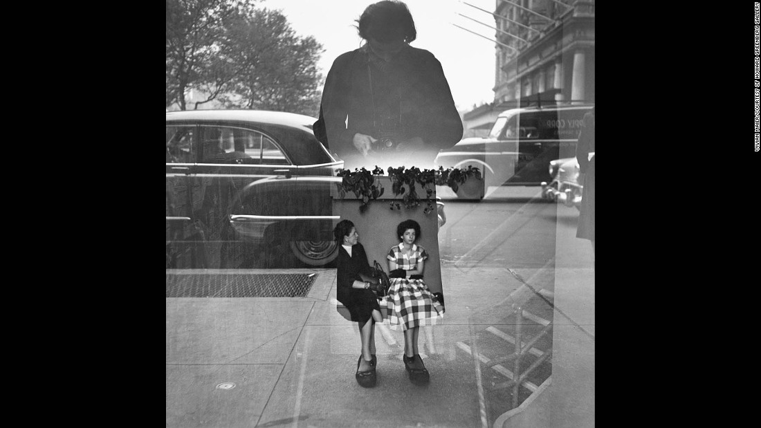 Maier photographs herself in what appears to be a glass window in 1954. However, there's more. Who are those other two women we see? And where exactly are they -- on the inside somewhere, or maybe on the outside? This kind of fantastical and imaginative element is characteristic of Maier's images, leading viewers' minds down a path of endless curiosities.