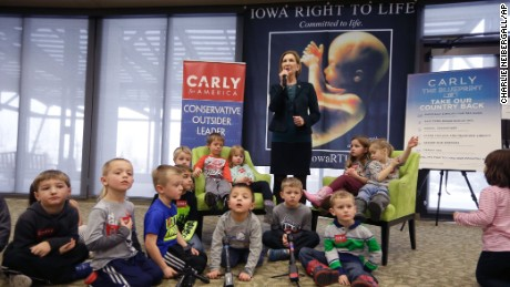 Republican presidential candidate Carly Fiorina is surrounded by preschool students as she speaks during the Iowa Right to Life Presidential Forum on Jan. 20, 2016, in Des Moines, Iowa.