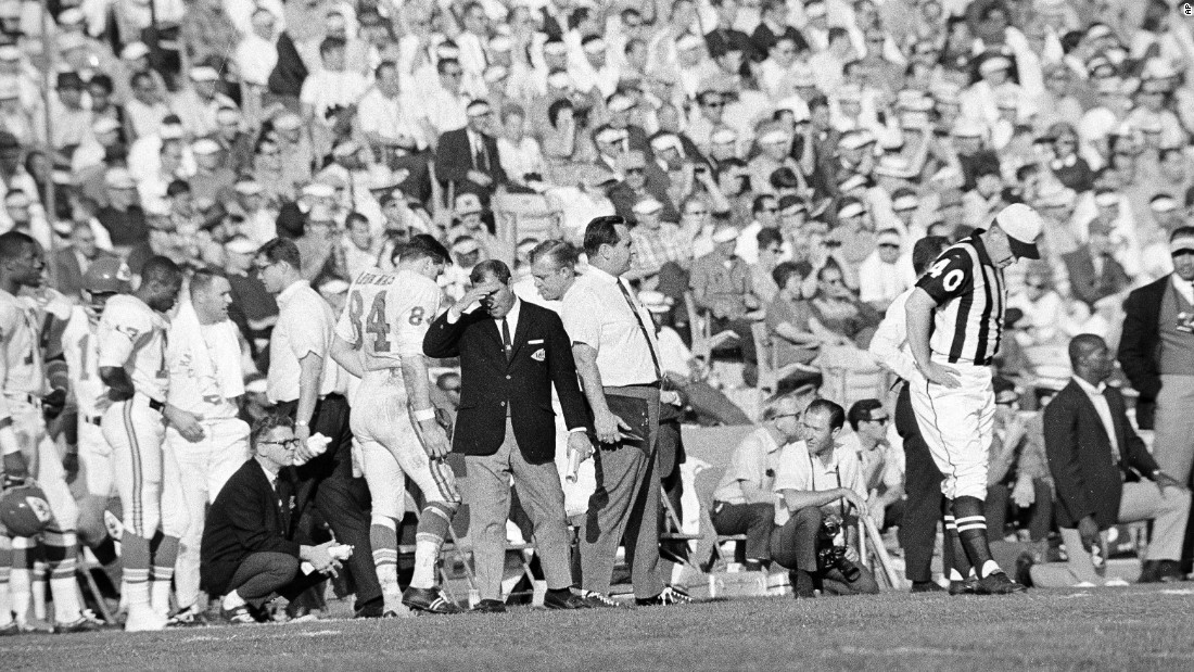 Chiefs head coach Hank Stram covers his face on the sideline. While this game did not go in his favor, he would be back three years later to win Super Bowl IV.