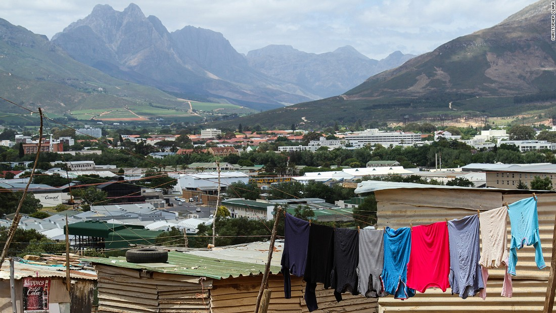 Enkanini is Cape Town's largest informal settlement. The lack of basic amenities contrasts with the natural bounty of the fertile rolling hills of the Cape Winelands.