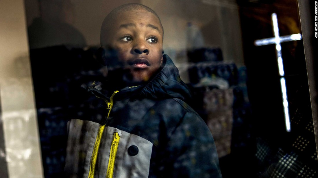 "Detroit resident Jaiden Ellis, 8, looks at stacks of free bottled water while the Rev. Jesse Jackson discusses <a href=""http://www.cnn.com/2016/01/18/us/flint-michigan-water-crisis-five-things/"" target=""_blank"">the water crisis in Flint, Michigan,</a> on Sunday, January 17. High levels of lead have plagued Flint's municipal water supply for more than a year, <a href=""http://www.cnn.com/2016/01/07/us/flint-michigan-water-governor-mayor-meeting/index.html"" target=""_blank"">prompting extensive emergency measures</a> to keep residents safe."