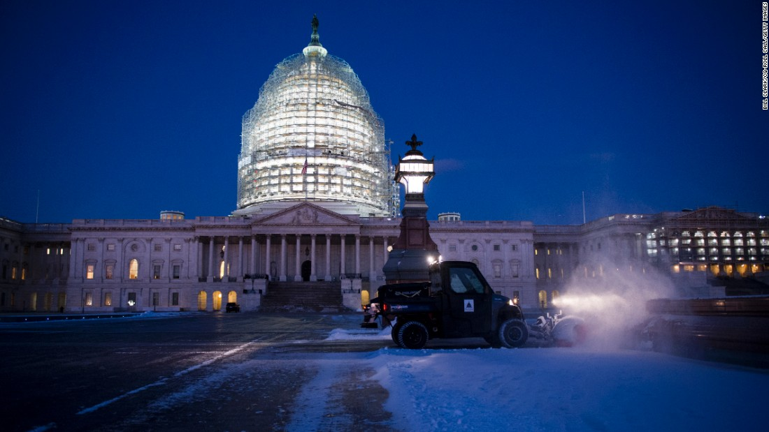 "Snow is cleared near the U.S. Capitol on Thursday, January 21. A storm left about an inch of snow in Washington as the region <a href=""http://www.cnn.com/2016/01/21/us/winter-snowstorm-washington-blizzard/index.html"" target=""_blank"">braced for blizzard conditions</a> over the weekend."