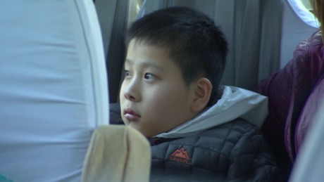 Abandoned Chinese boy heads 'home' to the US