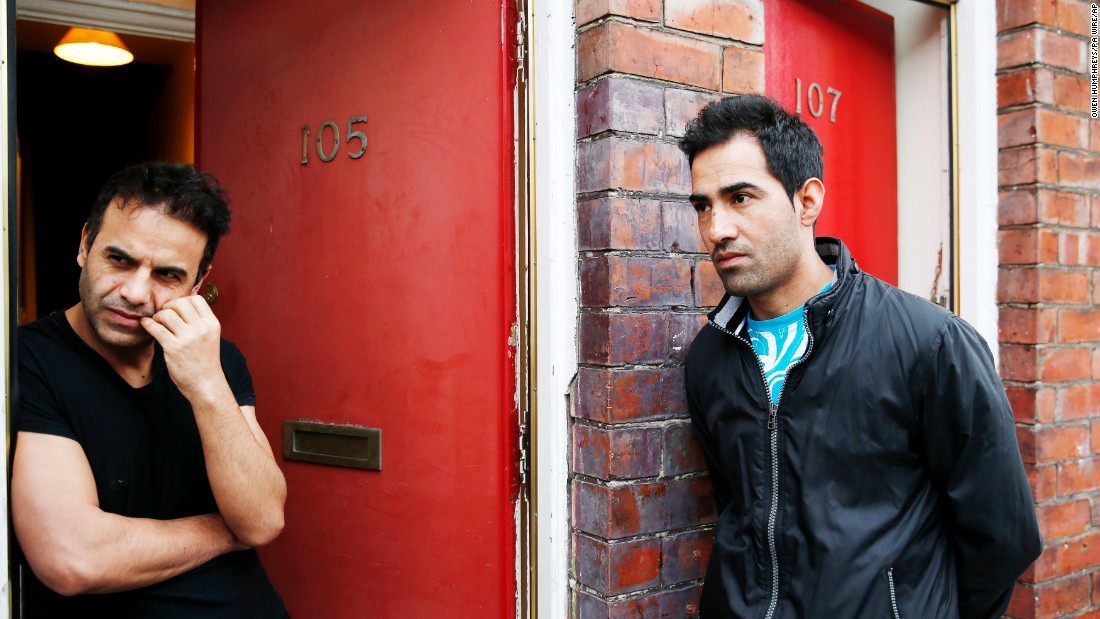 "Ajmal Kadari, left, and Rahumullah Ahmedi stand outside their homes in Middlesbrough, England, on Wednesday, January 20. The British government <a href=""http://www.cnn.com/2016/01/20/europe/europe-migrants-red-houses-uk/"" target=""_blank"">has ordered an urgent review of allegations</a> that asylum seekers in Middlesbrough were housed in homes with red-painted doors, making some residents targets of abuse. The company responsible for asylum seeker housing in the region told CNN there was ""categorically no policy to house asylum seekers behind red doors."" It said a subcontractor had used red paint on all properties serviced by the company."