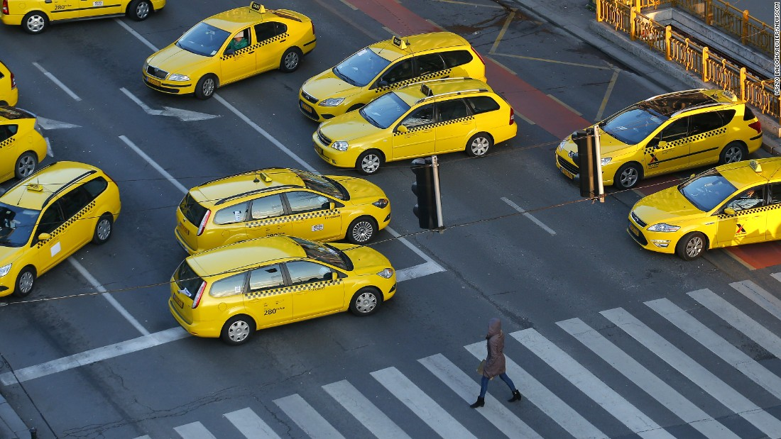 Taxis block a main road in Budapest, Hungary, to protest the online service Uber on Monday, January 18.