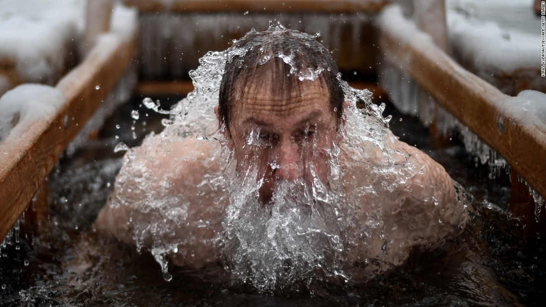A man in Moscow dips into the icy waters of a pond during Epiphany celebrations on Tuesday, January 19. Many believers jump into rivers and ponds to cleanse themselves with water deemed holy for the day.