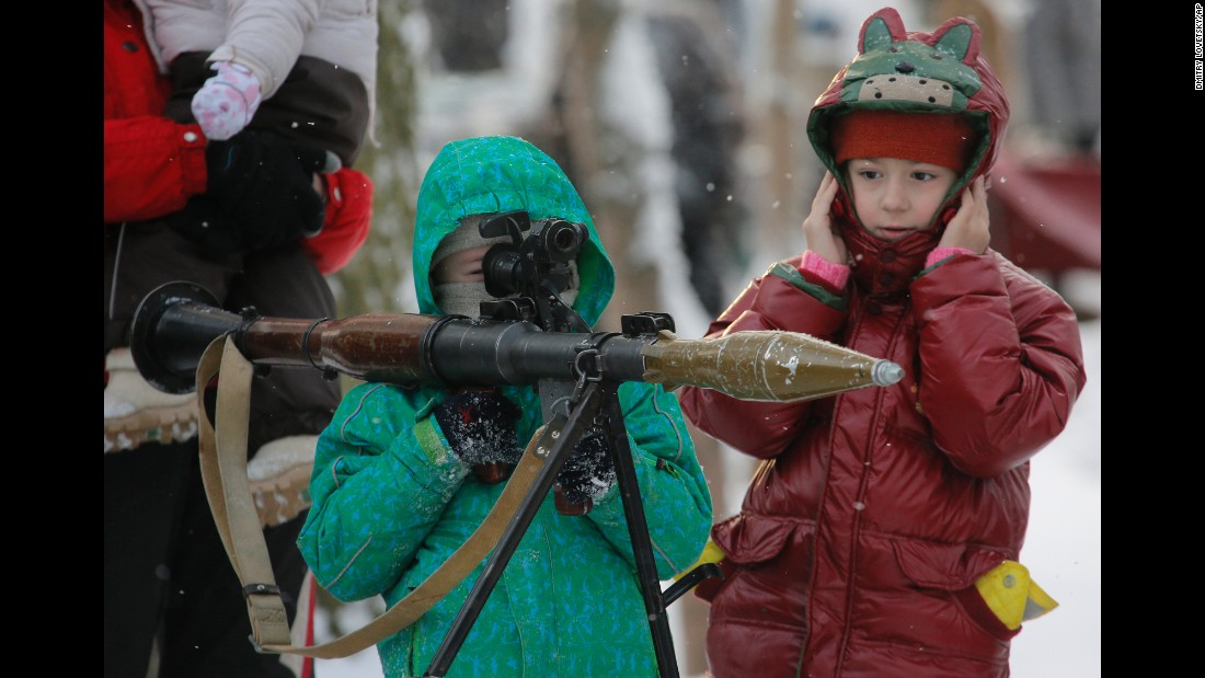 A boy aims a rocket-propelled grenade during a military show in St. Petersburg, Russia, on Sunday, January 17.