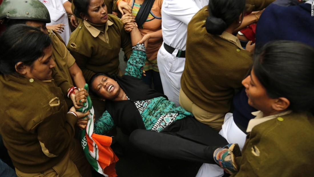 Police detain a protester in Kolkata, India, on Wednesday, January 20. The protest was in response to the recent suicide of a university student in Hyderabad, India. Demonstrators said the student and four others had been discriminated against by university officials.