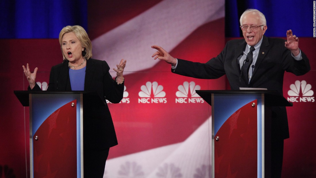 Democratic presidential candidates Hillary Clinton and Bernie Sanders speak simultaneously at a debate in Charleston, South Carolina, on Sunday, January 17.