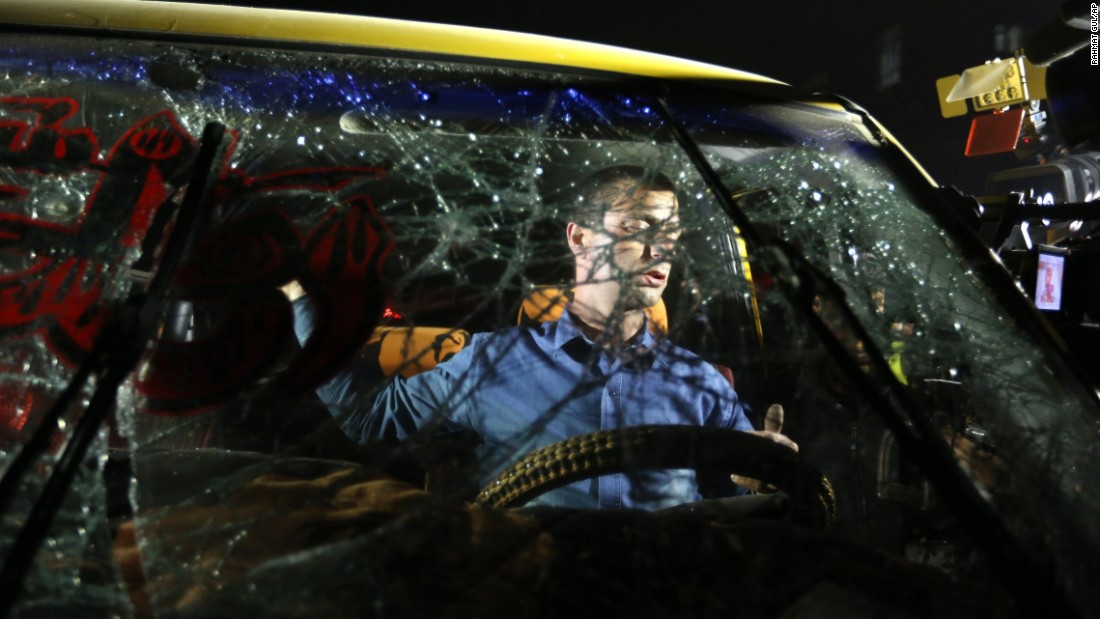 A man is seen through the shattered windshield of a car after a suicide bombing in Kabul, Afghanistan, on Wednesday, January 20. Afghan Deputy Interior Minister Mohammad Ayoub Salangi said six civilians, including four women, had died in the attack, and at least 24 others were wounded. The bomber, who was on a motorcycle, targeted a bus.