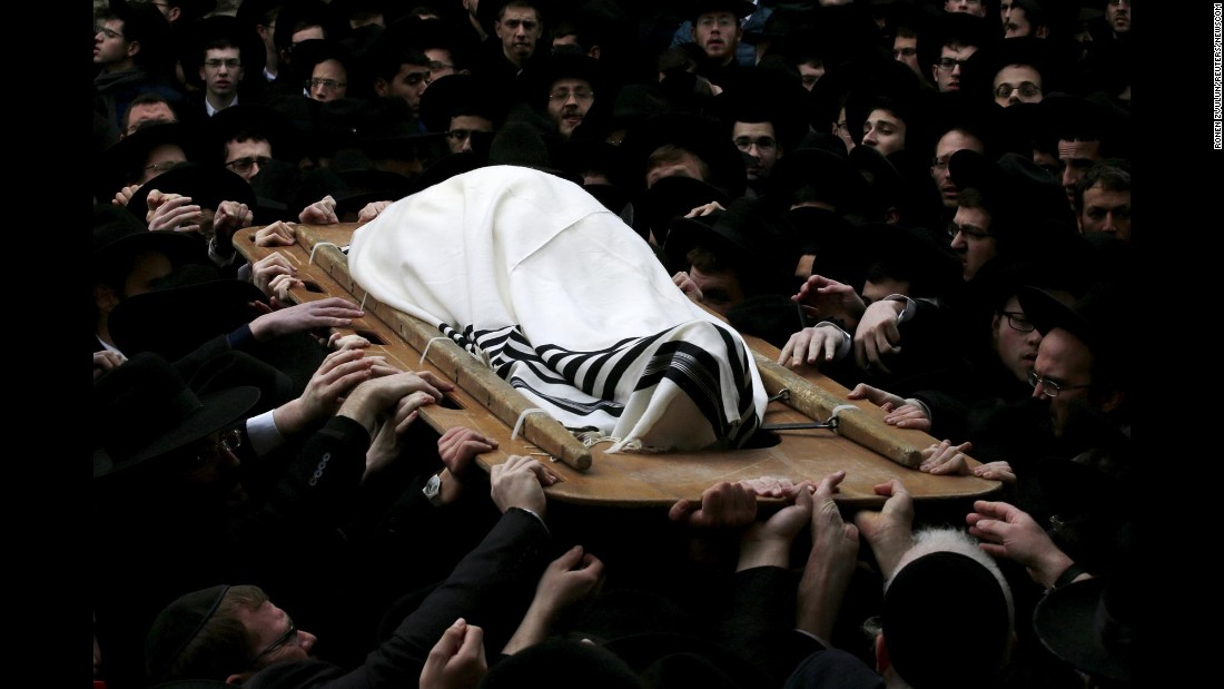 "Ultra-Orthodox Jewish men hold the body of rabbi Raphael Shmuelevich during his funeral in Jerusalem on Tuesday, January 19. The rabbi, head of the Mir Yeshiva, was 78. <a href=""http://www.cnn.com/2016/01/15/world/gallery/week-in-photos-0115/index.html"" target=""_blank"">See last week in 35 photos</a>"