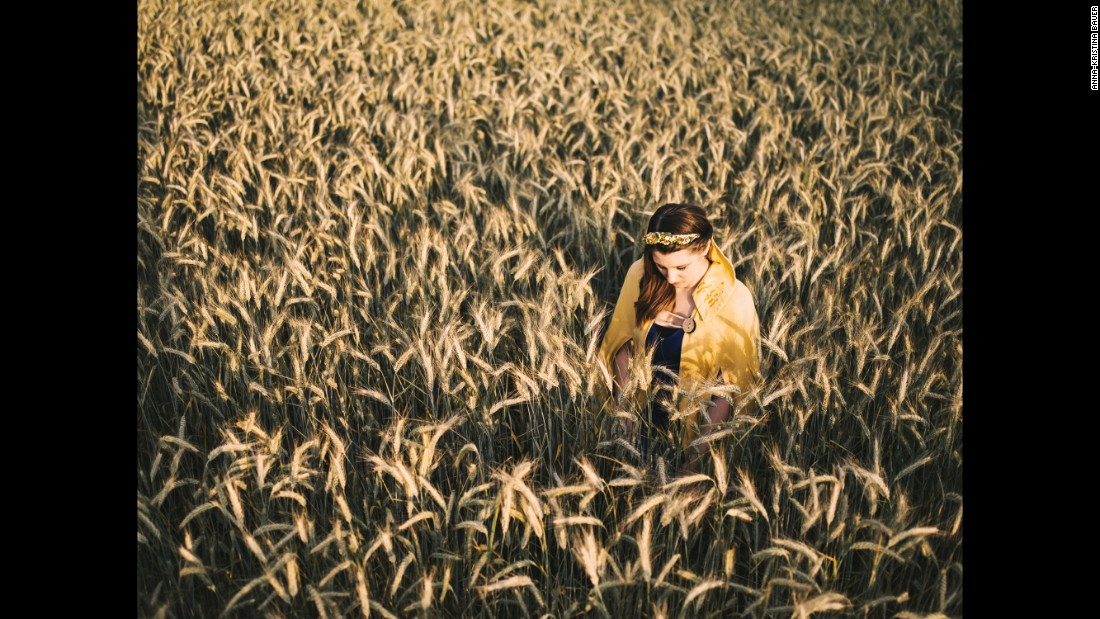 "The 2014-2015 Queen of the Wheat poses in a field in Bispingen, Germany. Many German industries elect a ""queen"" for promotional purposes and to serve as public ambassadors. Anna-Kristina Bauer photographed some for her project ""Twelve Queens."""
