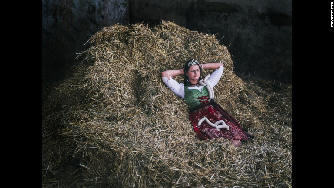 The Queen of the Bavarian Veal Sausage (2014-2015) lies on hay in Münchsteinach, Germany.