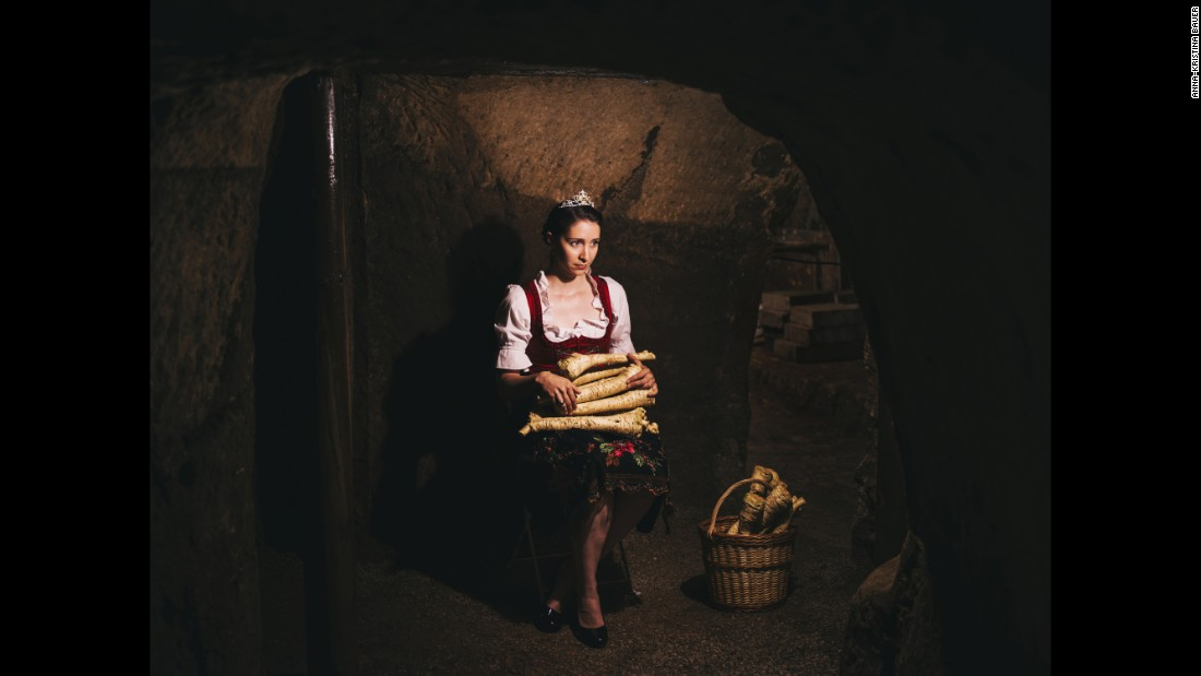 The Queen of the Horseradish (2013-2015) holds the vegetable at a storage cellar in Baiersdorf, Germany.