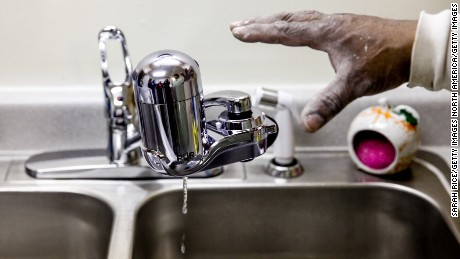 A water filter gets installed last month in a home in Flint, Michigan, as the city battles a toxic water crisis.