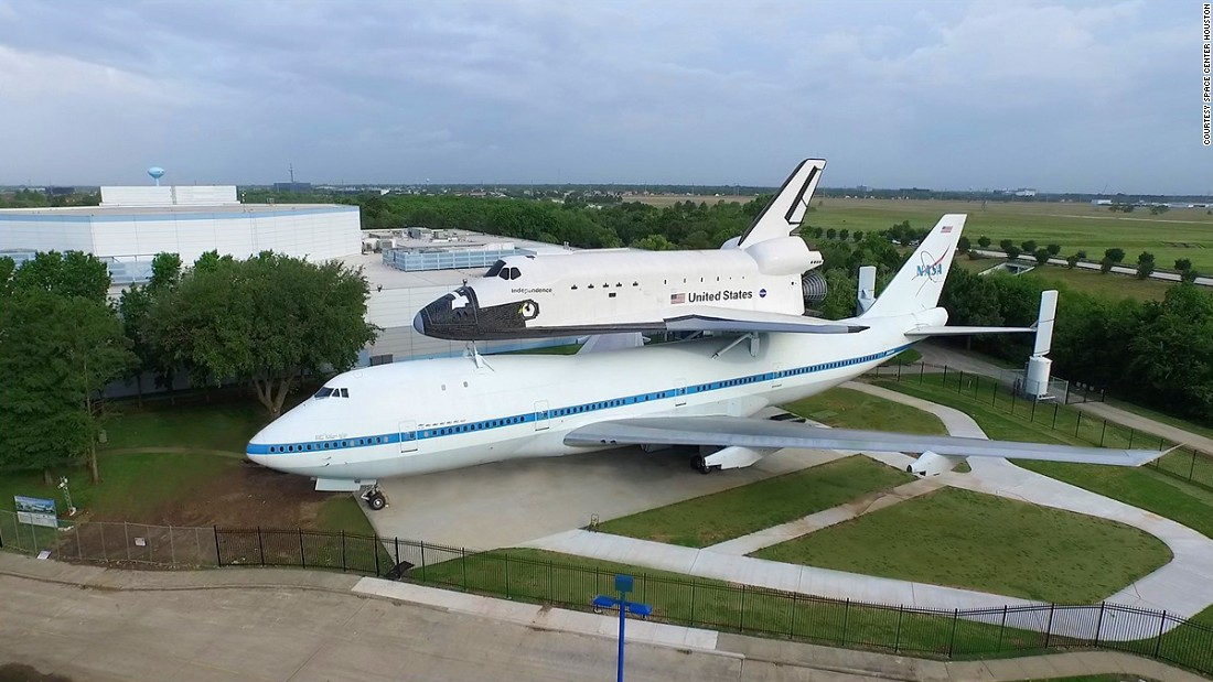 How does an airplane fly with an 83-ton spaceship strapped to its back? It takes a lot of jet power. NASA chose this four-engine Boeing 747-123 to perform the herculean task. It  piggybacked space shuttles 223 times during its career. On Saturday, Space Center Houston officially opens its Independence Plaza, featuring this plane, dubbed NASA 905. On top is a full-size space shuttle replica. Click through the images to see more of the exhibit.