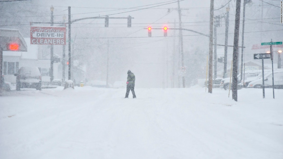 A person walks through the blowing snow in Bowling Green on January 22.