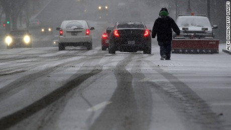 WASHINGTON, DC - JANUARY 22:  A man walks in the snow on Constitution Avenue January 22, 2016 in Washington, DC. A winter snowstorm is forecasted for the East Coast this weekend with prediction of up to two feet of snow for the DC area. (Photo by Alex Wong/Getty Images)
