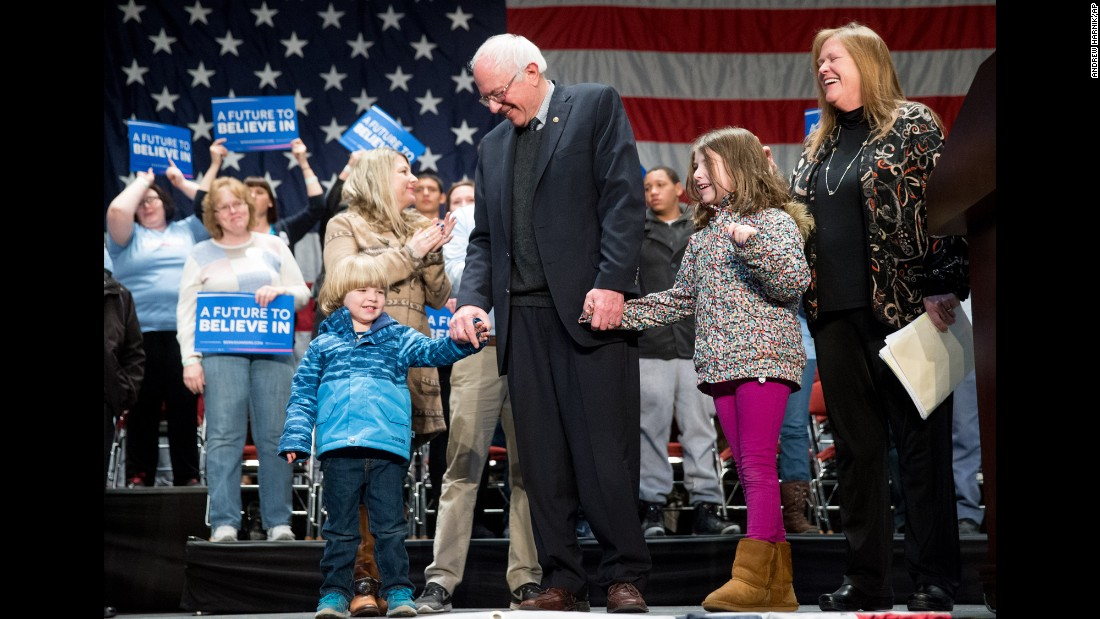 Sen. Bernie Sanders, a Democratic presidential candidate, holds the hands of his grandchildren Dylan and Ella after speaking in Sioux City, Iowa, on Tuesday, January 19.