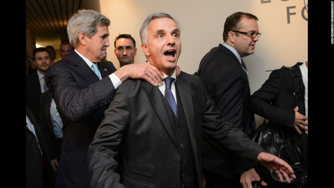 U.S. Secretary of State John Kerry, left, jokes around with Swiss Foreign Minister Didier Burkhalter while attending a meeting at the World Economic Forum in Davos, Switzerland, on Thursday, January 21.
